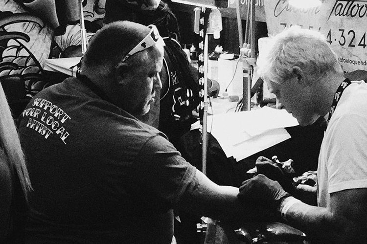 Chris getting a tattoo at the Orlando Tattoo Festival